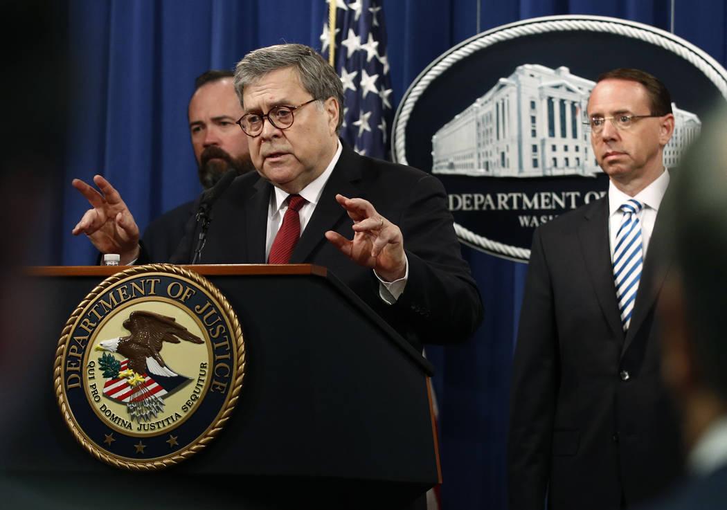 Attorney General William Barr speaks alongside Deputy Attorney General Rod Rosenstein, right, a ...