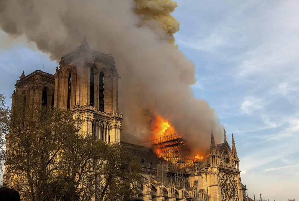 This photo taken on Monday April 15, 2019, shows Notre Dame cathedral burning in Paris. Firefig ...