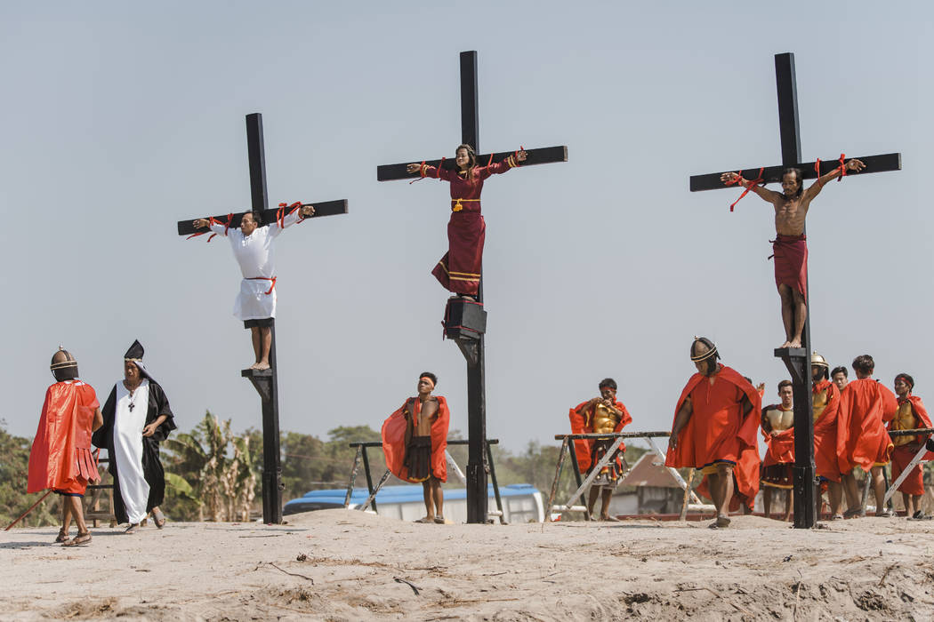 Three Filipino devotees are seen nailed on the cross as part of Good Friday rituals in the vill ...