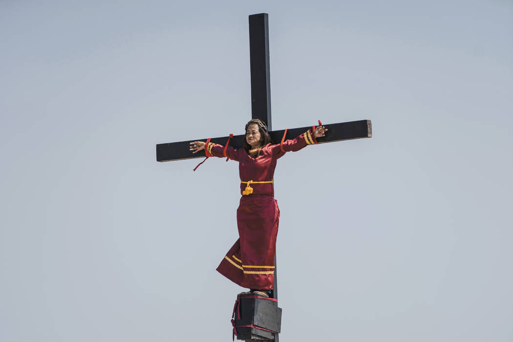 Mary Jane Sazon, the only woman to join in the crucifixion in the village this year, remains ca ...