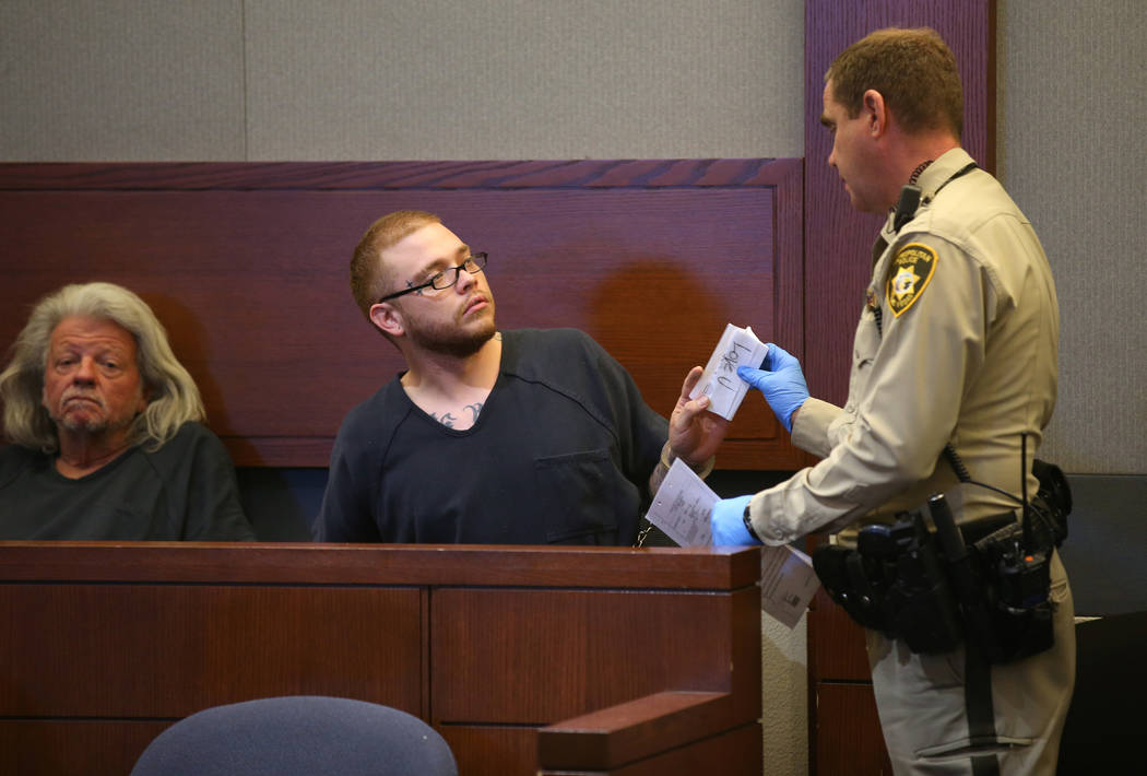 Jon Kennison, 27, is told to put a note that he had been displaying away during an appearance i ...