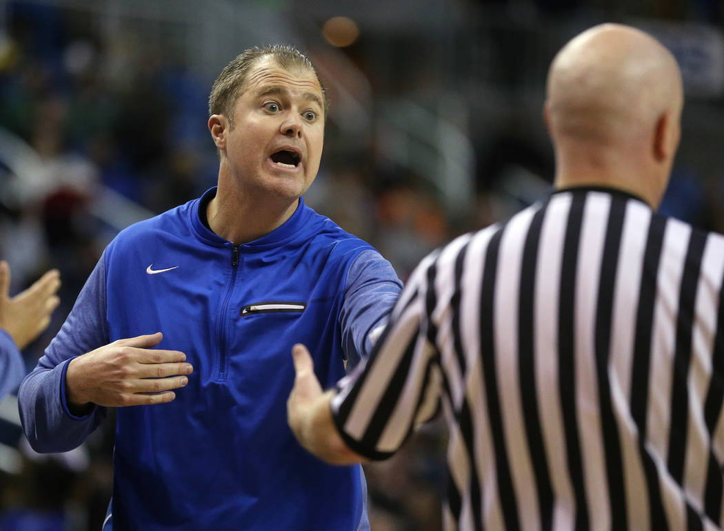 Bishop Gorman head coach Grant Rice works the 4A NIAA state basketball championship game agains ...
