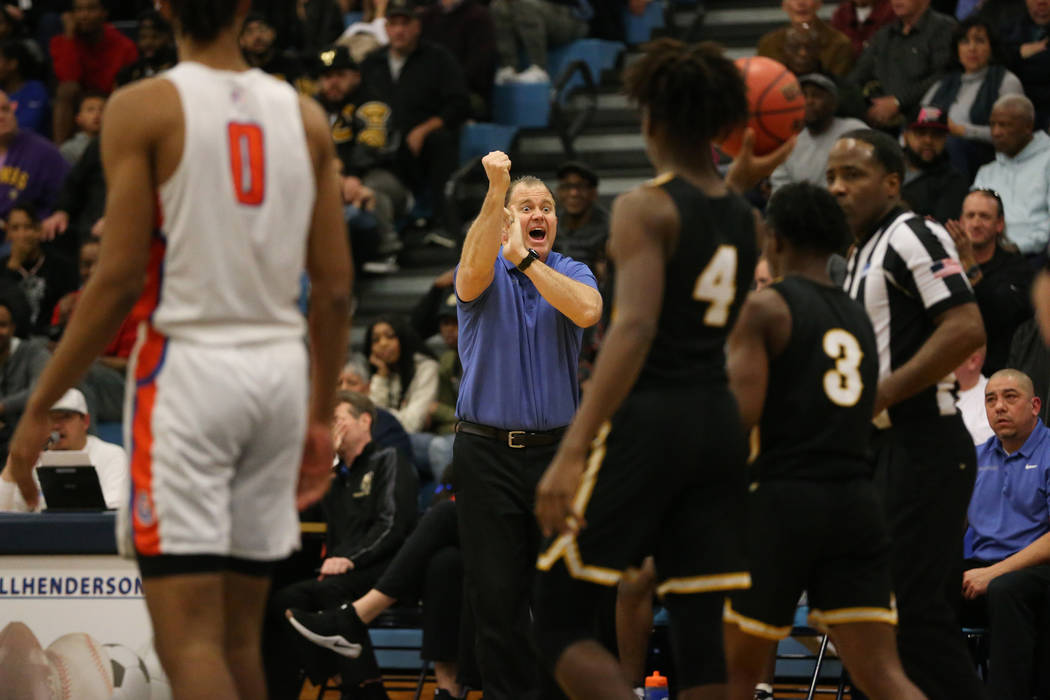 Bishop Gorman head coach Grant Rice reacts after a play against Clark in the Desert Region boys ...