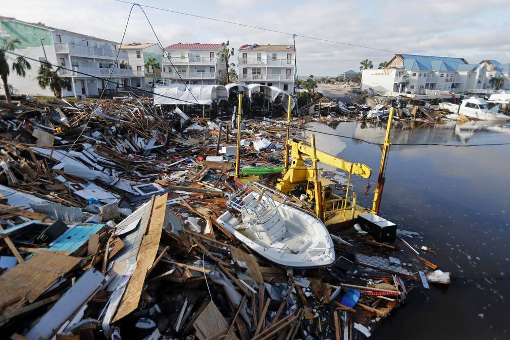 A boat sits amidst debris in the aftermath Oct. 11, 2018, of Hurricane Michael in Mexico Beach, ...