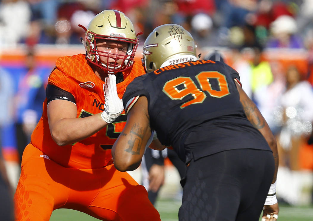 North offensive guard Chris Lindstrom of Boston College (75) blocks out South defensive tackle ...