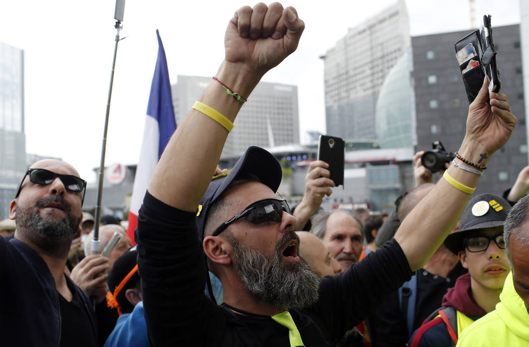 Jerome Rodriguez, center, a prominent figure of the yellow vests movement takes part in a rally ...