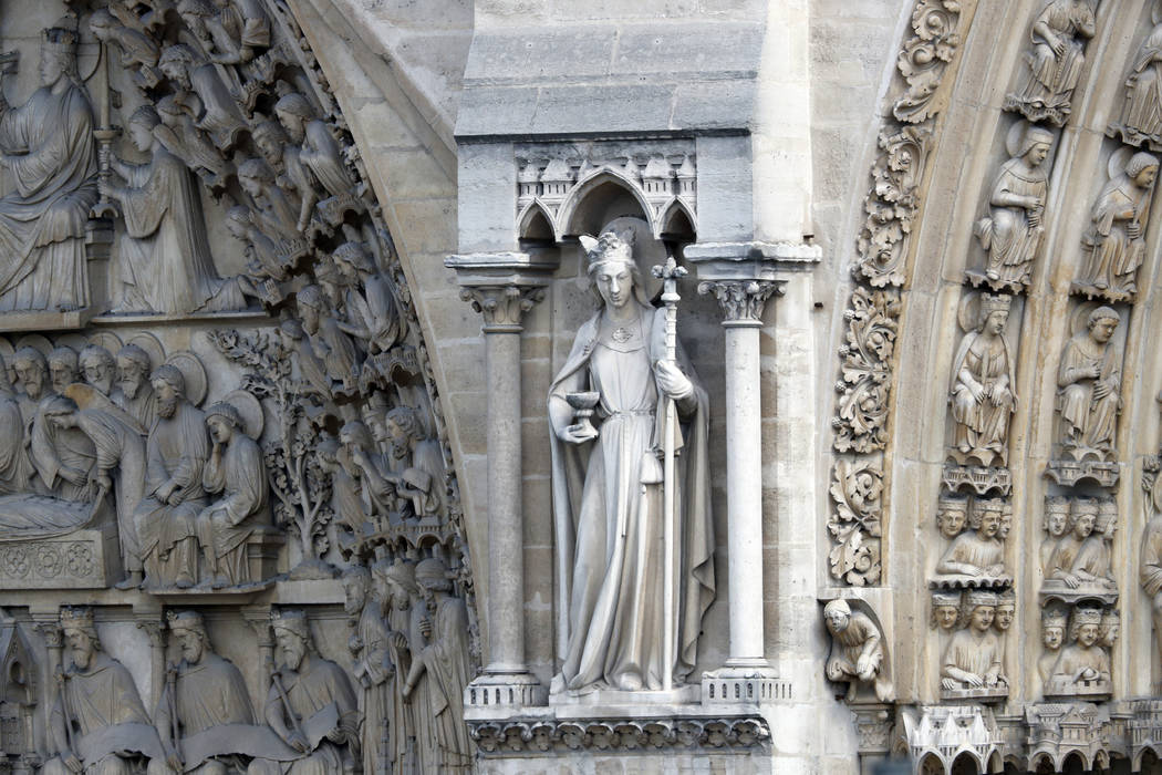 A statue is pictured just outside Notre Dame cathedral Wednesday, April 17, 2019 in Paris. Notr ...