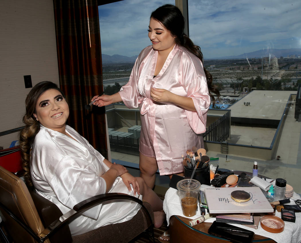 Bride Kimberly King gets her makeup done by her sister Cassie Castaneda in her room at the M Re ...