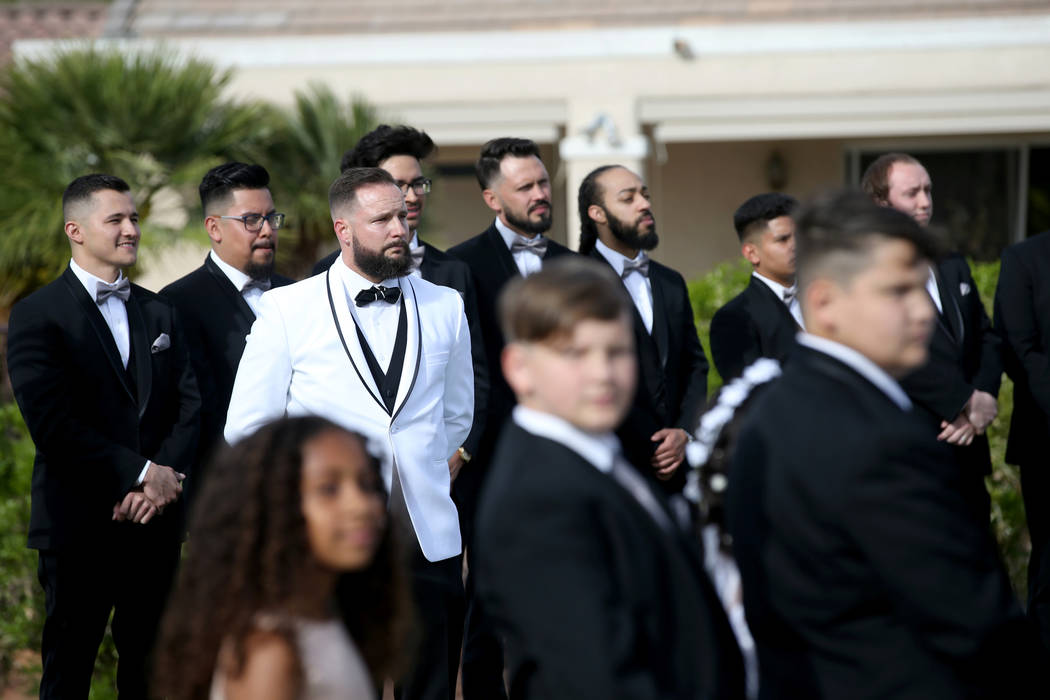 William King cries upon seeing his bride Kimberly at the Revere Golf Club in Henderson Friday, ...