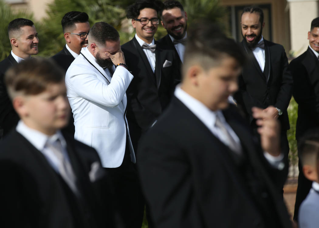 William King cries while his groomsmen laugh during his wedding ceremony at the Revere Golf Clu ...