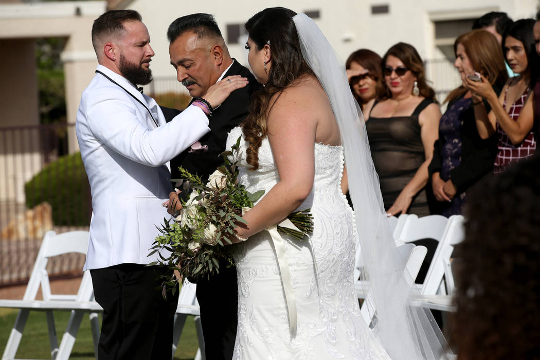 Kimberly King is given in marriage by her father Manuel Flores to her husband William King at t ...