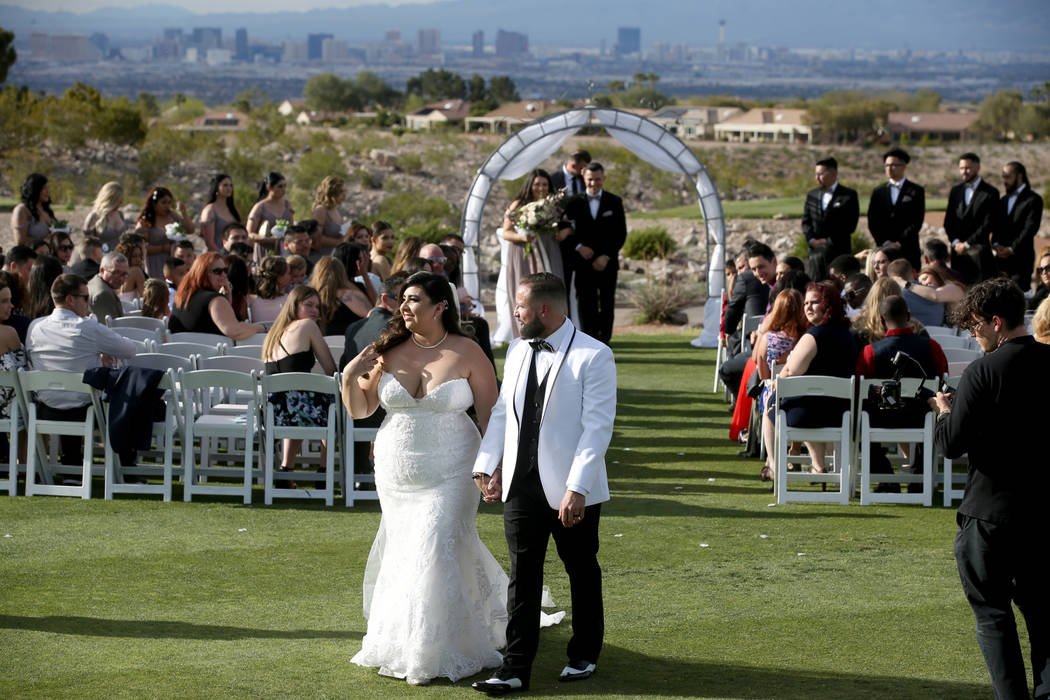 Kimberly and William King walk down the isle during their wedding ceremony at the Revere Golf C ...