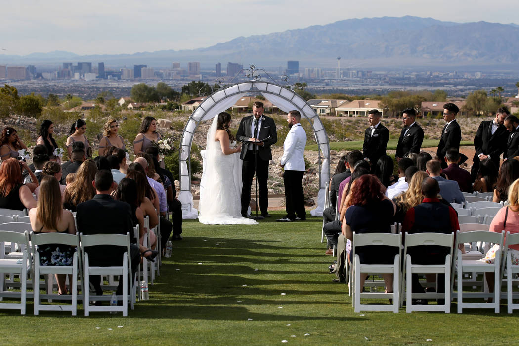 Kimberly and William King exchange vows at The Revere Golf Club in Henderson Friday, April 19, ...