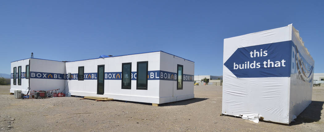 The exterior of a Boxabl home is shown at left in a lot near the company offices at 6120 N. Hol ...