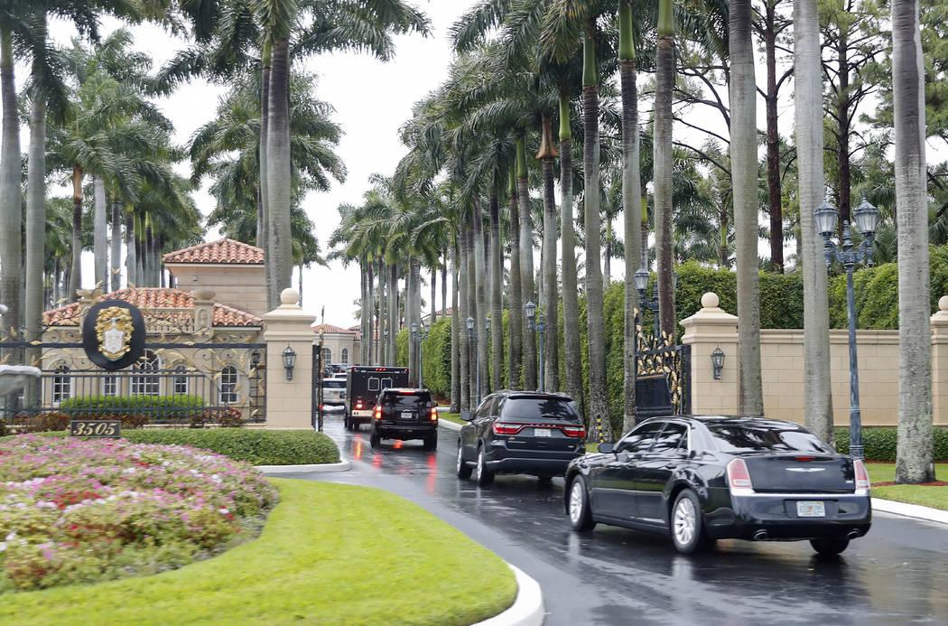 President Donald Trump and his accompanying motorcade vehicles arrive at Trump International Go ...