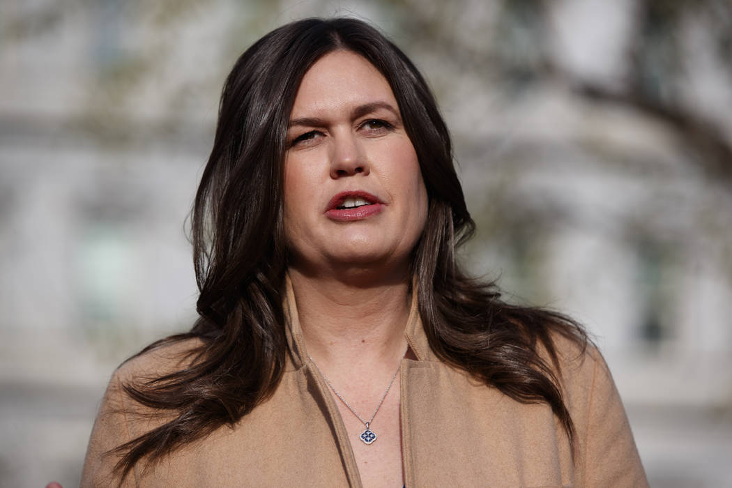 hite House press secretary Sarah Sanders talks April 4, 2019, with reporters outside the White ...