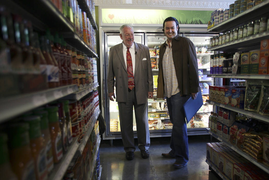 Then-Mayor Oscar Goodman, left, takes a tour of Resnick's Grocery with developer Sam Cherry on ...
