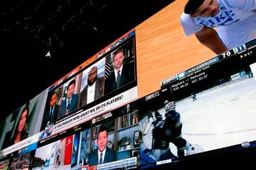 Giant video screens inside the sports betting lounge at the Tropicana casino in Atlantic City. ...