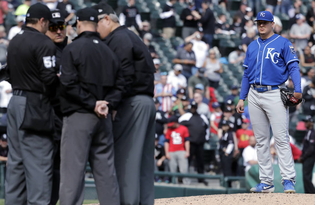 Kansas City Royals starting pitcher Brad Keller, right, looks at the umpires after Chicago Whit ...