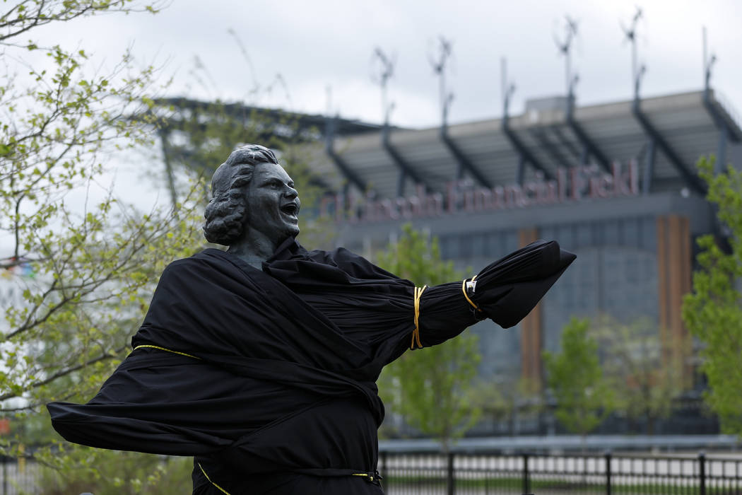 A partially covered statue of singer Kate Smith is seen near the Wells Fargo Center, Friday, Ap ...