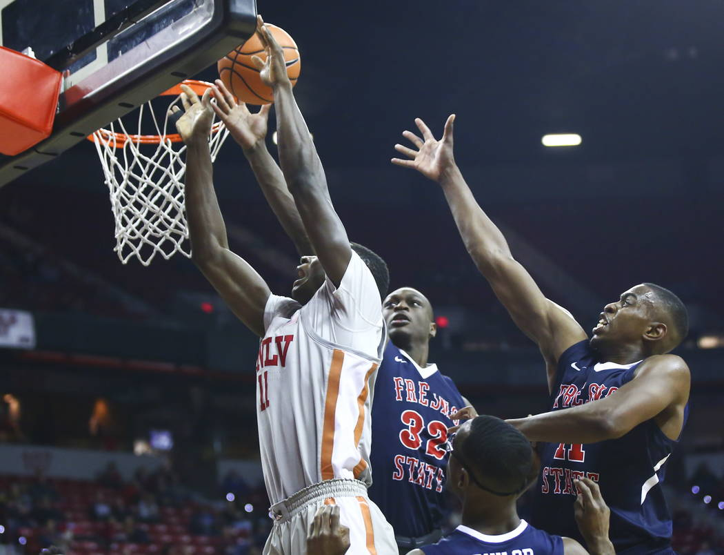 UNLV Rebels forward Cheickna Dembele (11) comes up short on a shot as Fresno State Bulldogs for ...