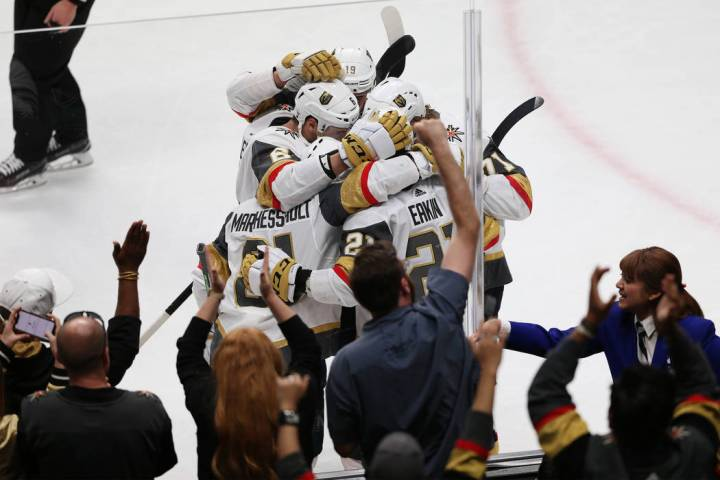 Vegas Golden Knights celebrate a score by center Jonathan Marchessault (81) during the third pe ...