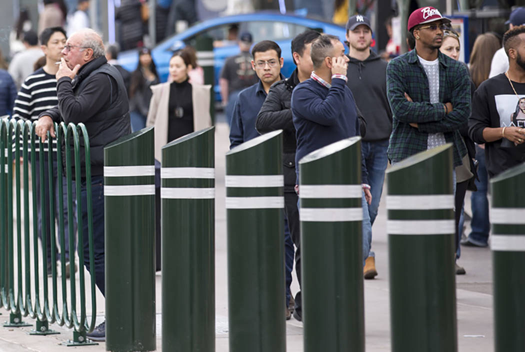 People walk past safety bollards on the Vegas Strip on Tuesday, Jan. 2, 2018. (Las Vegas Review ...