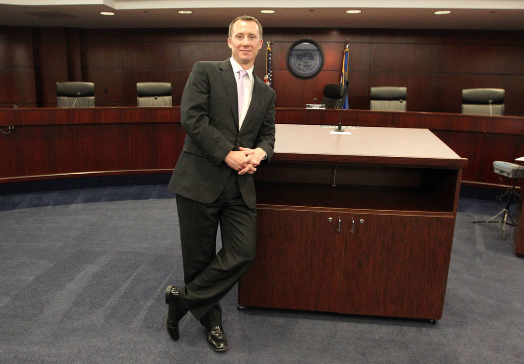 A.G. Burnett, chairman of the Nevada Gaming Board Commission, poses for a photo in the commissi ...