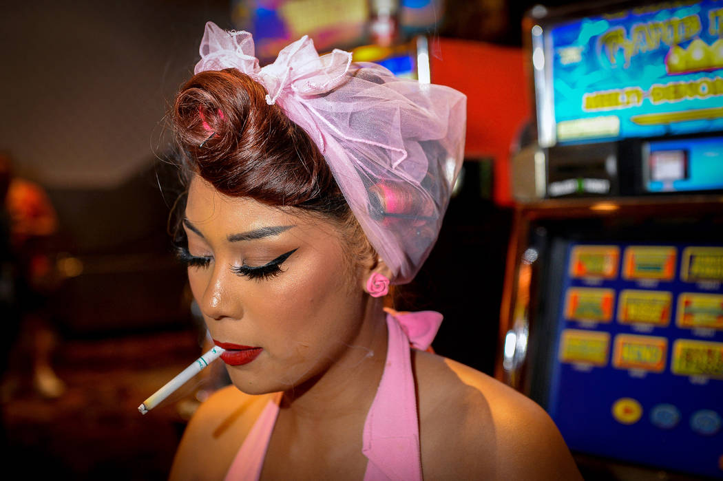 Kara Spade from Long Beach, Calif. smokes a cigarette while sitting at a slot machine at The Or ...