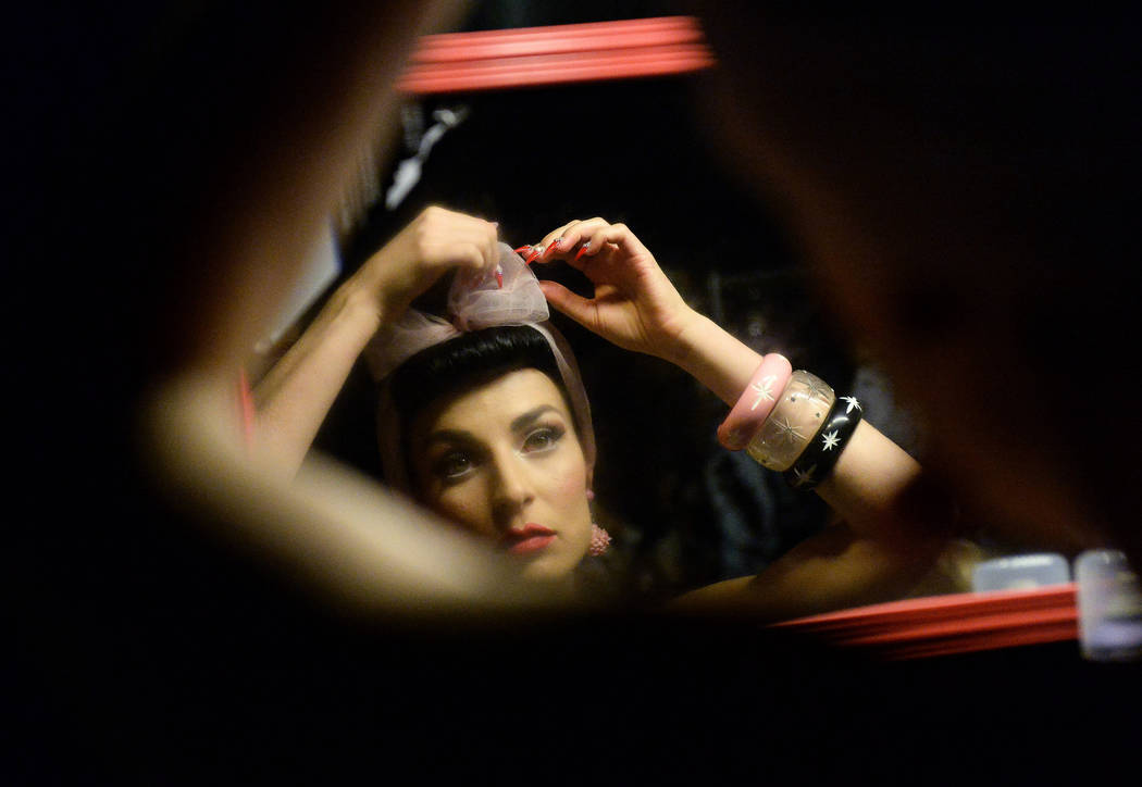 Lucy Luxe fixes a bow in her hair backstage of the fashion show at The Orleans during the Viva ...
