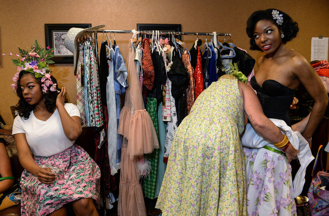 Jessabelle Thunder from Los Angeles, left, fixes her hair while designer Jamie Trujilo from Los ...
