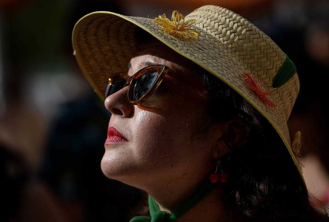 Danika Soto Hay from San Diego, Calif. watches a performance at the pool at The Orleans during ...