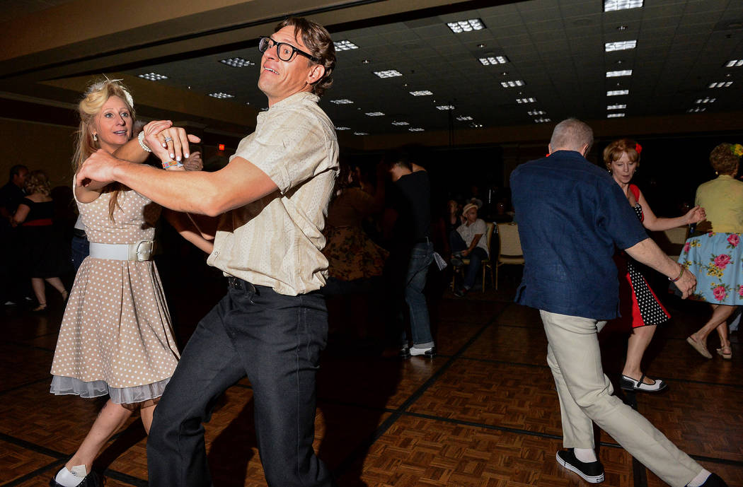 Linda Lou, left, and Jay Greaves from Canada dance to live music at The Orleans during the Viva ...