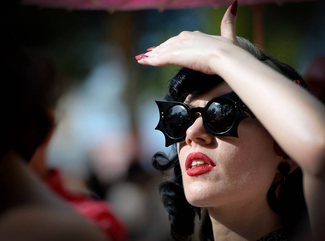 Jess Wehrle from N.Y. watches a performance at the pool at The Orleans during the Viva Las Vega ...