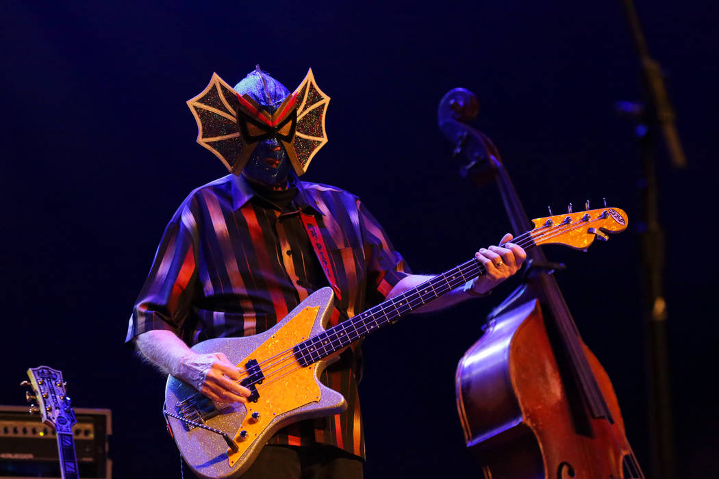 Pete Curry, bassist for Los Straitjackets, performs at the Deke Dickerson Guitar Geek Festival ...