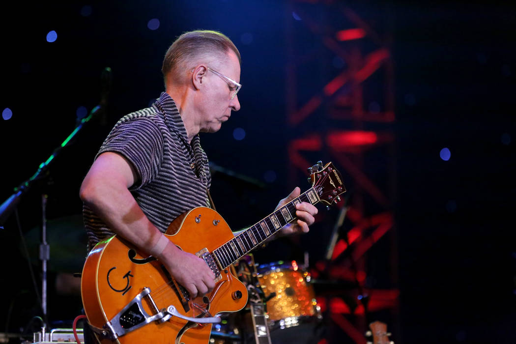 Reverend Horton Heat guitarist, Jim Heath, entertains a late night crowd at the Deke Dickerson ...
