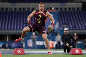 Utah linebacker Cody Barton runs a drill at the NFL football scouting combine in Indianapolis, ...
