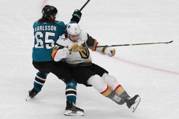 San Jose Sharks defenseman Erik Karlsson (65) takes down Vegas Golden Knights center William Ka ...
