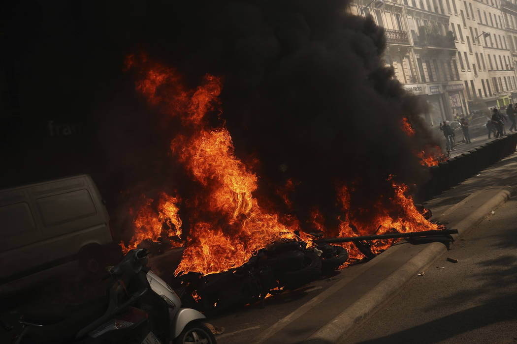 Motorbikes set alight during a yellow vest demonstration in Paris, Saturday, April 20, 2019. Fr ...
