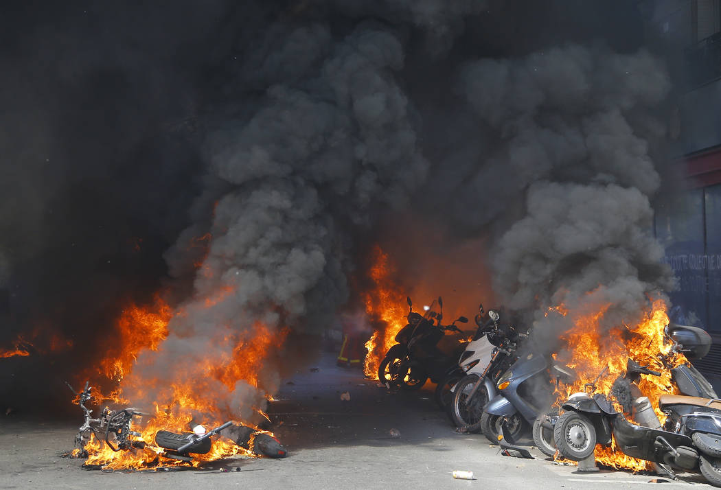 Motorbikes are set alight during a yellow vest demonstration in Paris, Saturday, April 20, 2019 ...