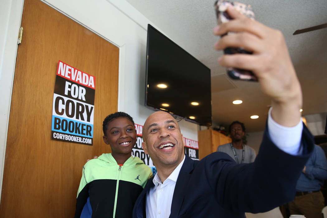 Democratic presidential candidate Sen. Cory Booker, D-N.J., takes a photo with Jeremiah Daniels ...