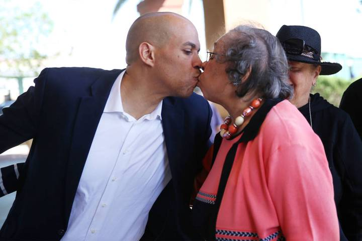 Democratic presidential candidate Sen. Cory Booker, left, kisses his mother Carolyn, following ...