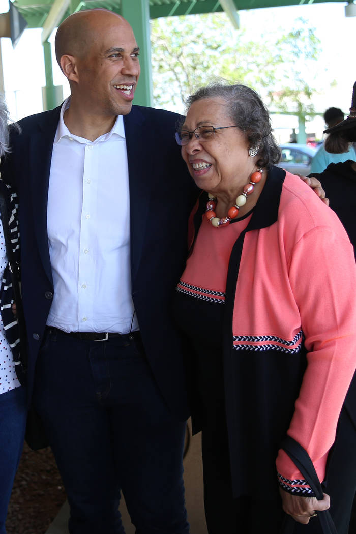 Democratic presidential candidate Sen. Cory Booker, D-N.J., left, with his mother Carolyn, embr ...
