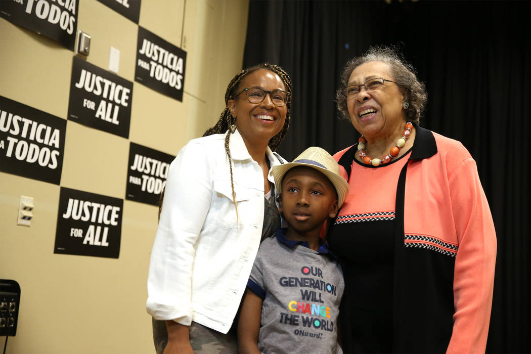 Demetria Giles, from left, with her son Justice Santiago, 7, of Las Vegas, take a photo with Ca ...