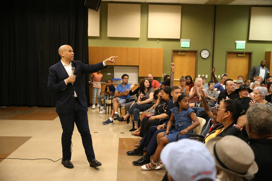 Democratic presidential candidate Sen. Cory Booker, D-N.J., left, speaks during an event at the ...