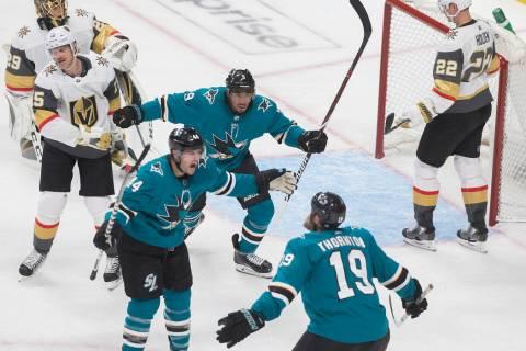 San Jose Sharks defenseman Marc-Edouard Vlasic (44) celebrates with teammates Joe Thornton (19) ...