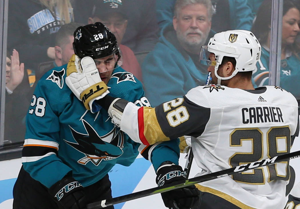 Vegas Golden Knights left wing William Carrier (28) swings at San Jose Sharks right wing Timo M ...