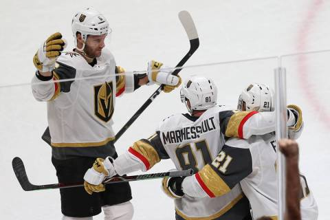 Vegas Golden Knights center Jonathan Marchessault (81) celebrates a score with center Cody Eaki ...