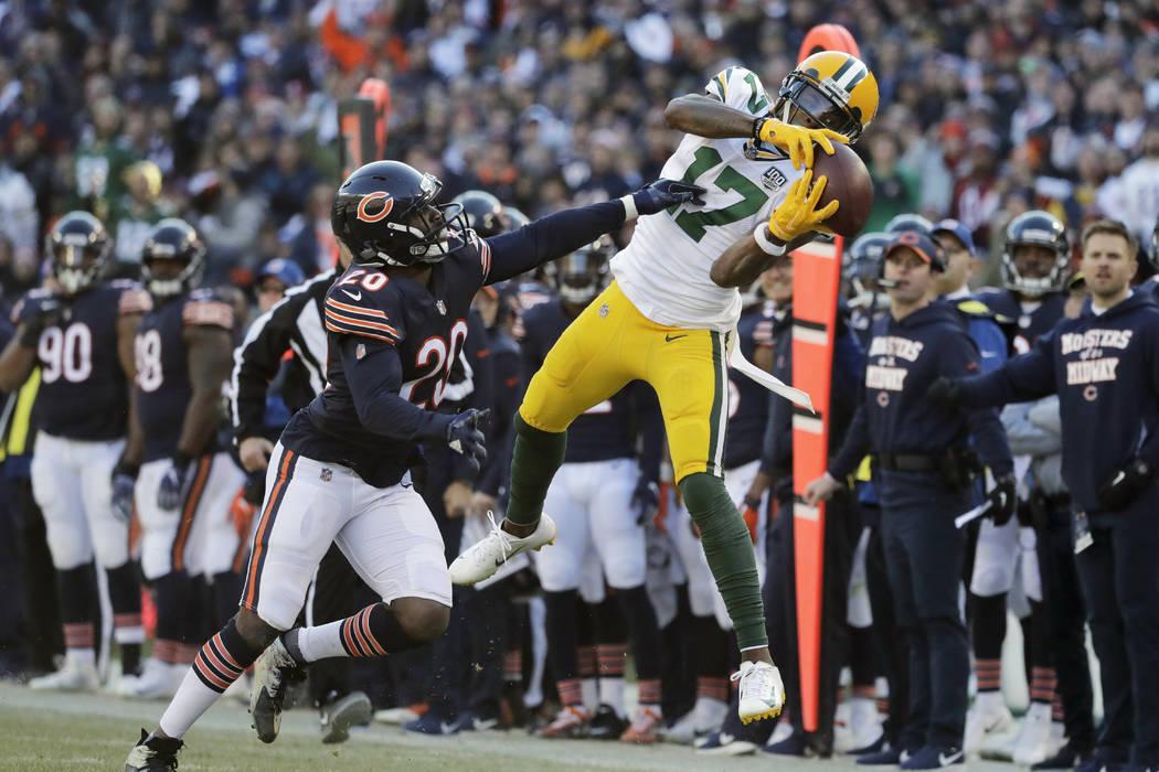 Green Bay Packers wide receiver Davante Adams (17) makes a catch against Chicago Bears cornerba ...