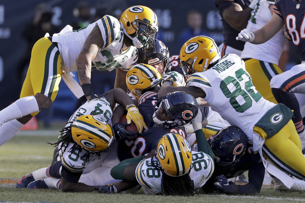 Chicago Bears running back Benny Cunningham (30) is tackled by Green Bay Packers defenders duri ...
